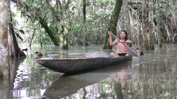 Indigenous hunter on wooden canoe Footage