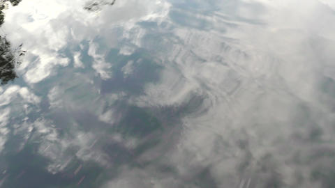 Clouds reflection into Clearwater river Footage