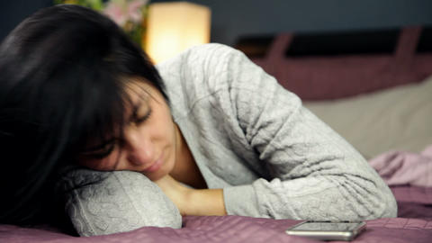 Young woman in bed not being able to sleep feeling sick Live Action