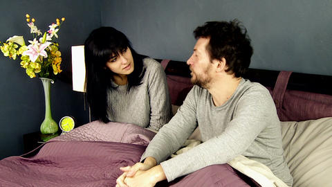 Man not able to tell the truth to wife in bed Footage