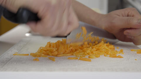 Home Cook Dicing Carrots. 4K UHD stock footage
