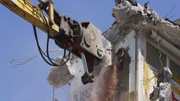 crane munching urban industrial construction building Footage