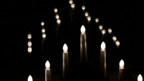 Racking Focus Shot Of Electric Candles In Christmas Time stock footage