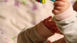 Baby 26 plyaing hands Stock Video Footage