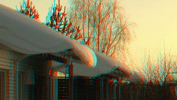Snow on the roofs at sunset 2 (combo) Stock Video Footage