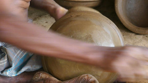 hands of a potter manufactured a pot of clay Footage