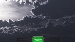 4K Passing Ayers Rock Uluru Australia Highway Sign at... Stock Video Footage