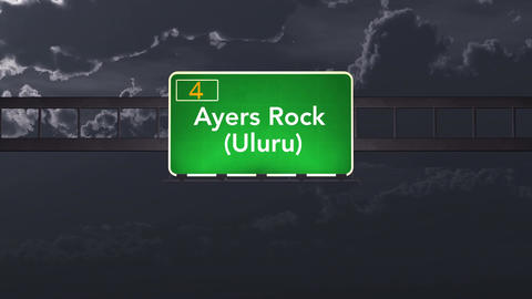 4K Passing Ayers Rock Uluru Australia Highway Sign at Night with Matte 1 neutral Animation