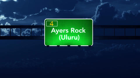 4K Passing Ayers Rock Uluru Australia Highway Sign at Night with Matte 2 stylize Animation