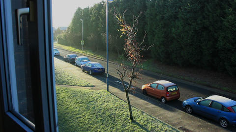 Frosty Day In England - Window View Of Quiet Residential Street And Carpark stock footage