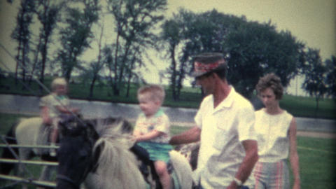 (8mm Vintage) Boy On Old Time Horse Ride stock footage