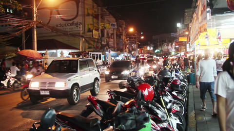 PATTAYA, THAILAND - JULY 11, 2014: Traffic On Street Of Pattaya City In Night stock footage