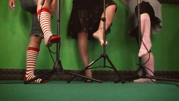 Feet green caressing mic stand Footage