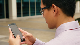 Chinese Businessman Typing Message On Smartphone Mobile Phone Footage