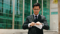 Portrait Chinese Businessman Tearing Contract And Throwing Papers stock footage