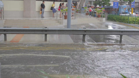 singapore taxi driving through flooded street Footage