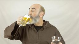 Friar choose water or beer Footage