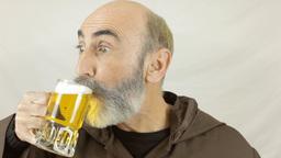 Friar choose beer close up Footage