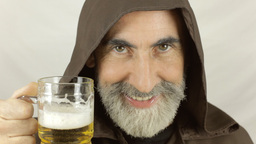 Friar front face drink beer Footage