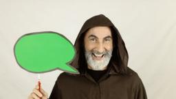 Friar Holding Green Speech Balloon Funny stock footage