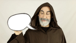 Friar Holding White Speech Balloon Cartoonish stock footage