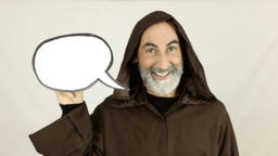 Friar holding white speech balloon smiling Footage