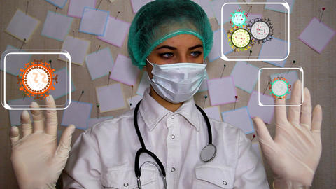 A young doctor with a syringe wearing a mask examines the variety of viruses on  Footage