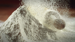 Falling Flour On Wooden Surface stock footage