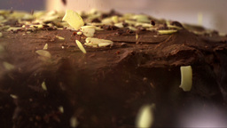 Falling Pieces Of Almonds, Hazelnuts And Walnuts In A Chocolate Cake 2 stock footage