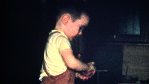 (8mm Vintage) Christmas 1957 Kid Plays With Bunny Toy Footage