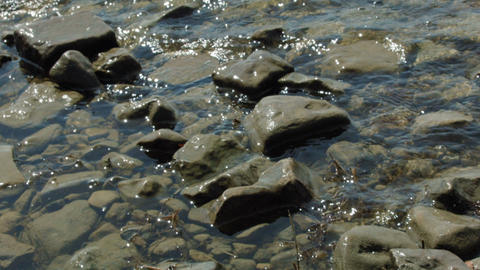 Close Up Little Rock In The Lake Water Wave stock footage