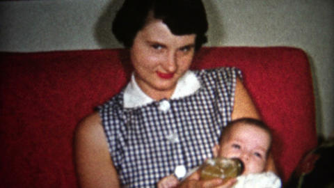 (8mm Vintage) 50's Girl Taking Care of Baby 1957 Live Action