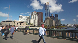 People walking across the Princes Bridge in Melbourne, Australia Footage