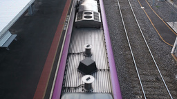 High angle shot of a train arriving at a railway station Footage