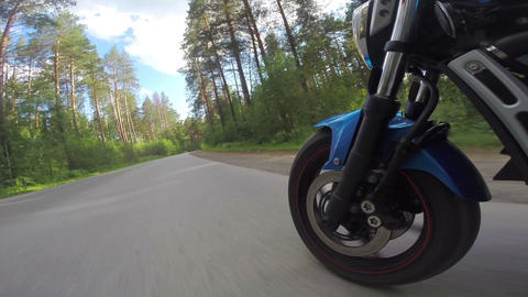 Riding a motorcycle, view on front wheel Footage