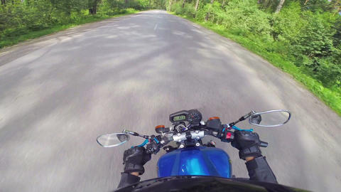 Motorcycle rider on a road, view from helmet Live Action