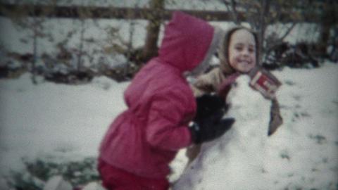 (8mm Film) Kids Building Snowman 1955 Footage