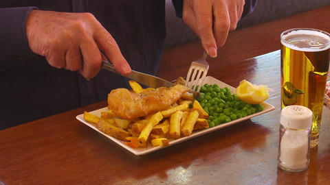 Man tucks in to fish and chips Footage