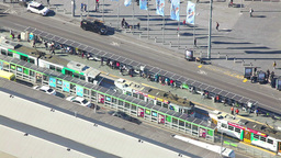 Timelapse video of busy tram station and traffic in Melbourne Footage