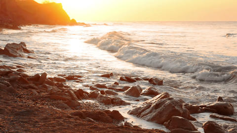 Golden Dawn On The Rocky Shore stock footage