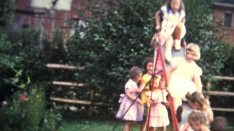 (8mm Film) Girls in Formal Dress Playing on Slide 1956 Footage