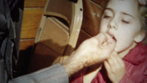 (8mm Film) Girl Getting Tooth Pulled at Home 1955 Live Action