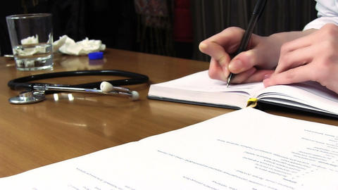 Doctor Writing The Note stock footage