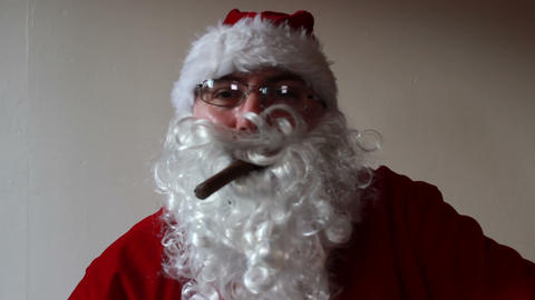 Santa Claus Smoking A Cigar And Entangling In His Own Beard stock footage
