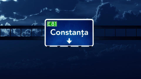 4K Passing Constanta Romania Highway Sign At Night With Matte 2 Stylized stock footage