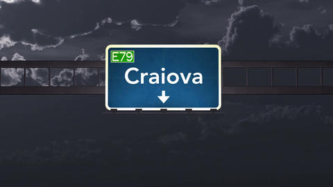 4K Passing Craiova Romania Highway Sign At Night With Matte 1 Neutral stock footage
