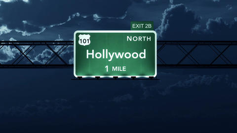 4K Passing Hollywood USA Interstate Highway Road Sign At Night With Matte 2 Styl stock footage