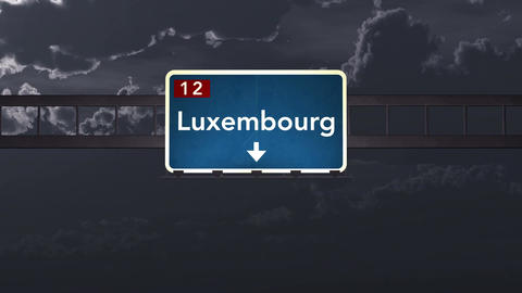 4K Passing Luxembourg Highway Sign at Night with Matte 1 neutral Animation