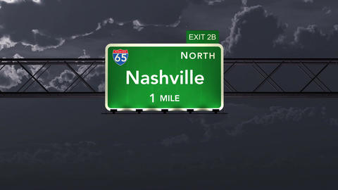 4K Passing Nashville USA Interstate Highway Road Sign at Night with Matte 1 neut Animation