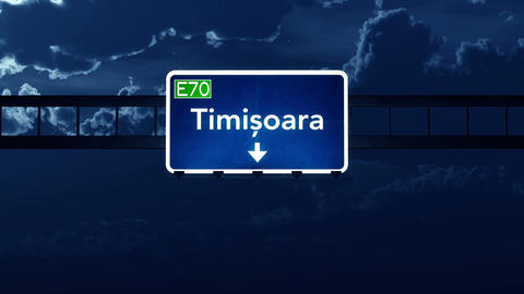 4K Passing Timisoara Romania Highway Sign At Night With Matte 2 Stylized stock footage